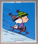 Linus & Snoopy sledding Framed Print