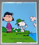 Snoopy looking through cards with Lucy Framed Print