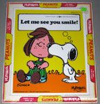 Snoopy kissing Peppermint Patty 'Let me see you smile' Puzzle