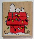 Snoopy on Christmas lighted doghouse Rubber Stamp