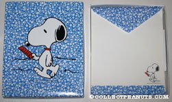 Snoopy reading paper on blue flower background Stationery