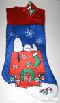 Snoopy laying on decorated doghouse Stocking
