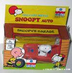 Snoopy in Orange Car