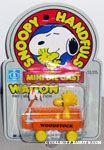 Woodstock sitting in orange wagon