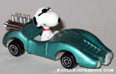 Snoopy Joe Cool in green race car