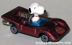Snoopy in purple race car