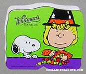 Sally wearing witch hat sorting treats with Snoopy Halloween Chocolate Box
