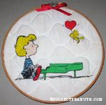Woodstock bringing Schroeder a heart balloon Fabric in Hoop