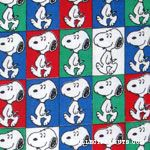 Snoopy walking in colored squares Fabric