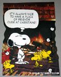 Snoopy and Woodstocks by fireplace