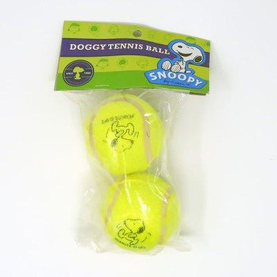 Snoopy kicking dog tennis balls