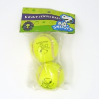 Snoopy kicking dog tennis balls