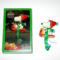 Snoopy and Woodstock on Sled Stocking Holder