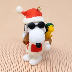 Joe Cool as Santa with Woodstock in bag Ornament