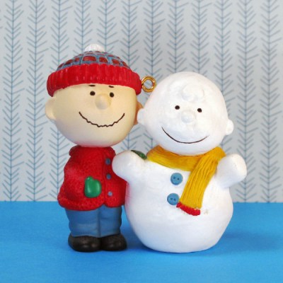Charlie Brown making a Snowman Ornament