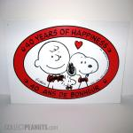 Peanuts 40 Years of Happiness Sign in English and French