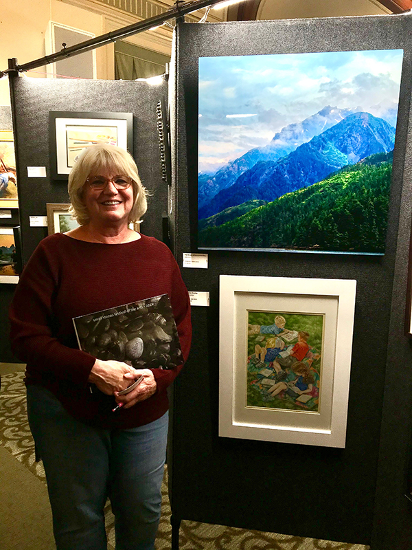 Colleen B. Reilly with her photograph at 2019 Small Stones Festival of the Arts