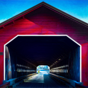 Red covered bridge crossing in Massachusetts