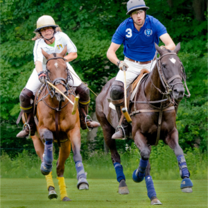 Man and woman on polo ponies racing for the ball