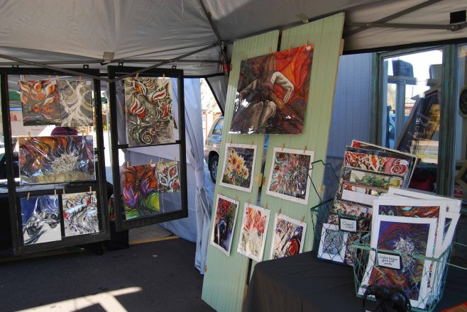 Original unframed art for sale at a recent outdoor market.