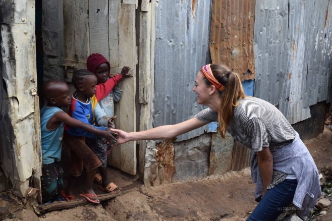 My dearly loved friend Jasmine, greeting children in Marthare.