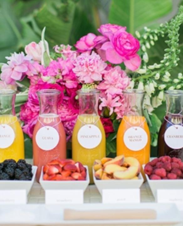 tropical bridal shower fruit juice display