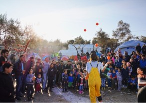 An international troupe of volunteer circus performers bring smiles to the otherwise somber Moria transit camp. Lesvos, December 2015.