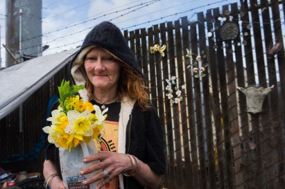 """""""Hippie Flower"""" proudly shows off how she's decorated her camp. She's been homeless for several years, and is an influential person in her community of people sleeping in this part of town. Portland, Oregon, February 2016."""