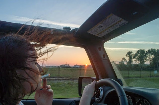 girl smoking in jeep sunset florida