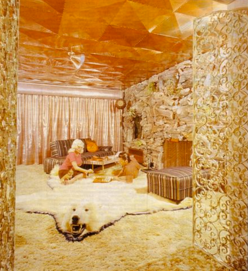 Jayne Mansfield's Pink Palace | Jayne and her husband play a board game on the polar bear skin rug.