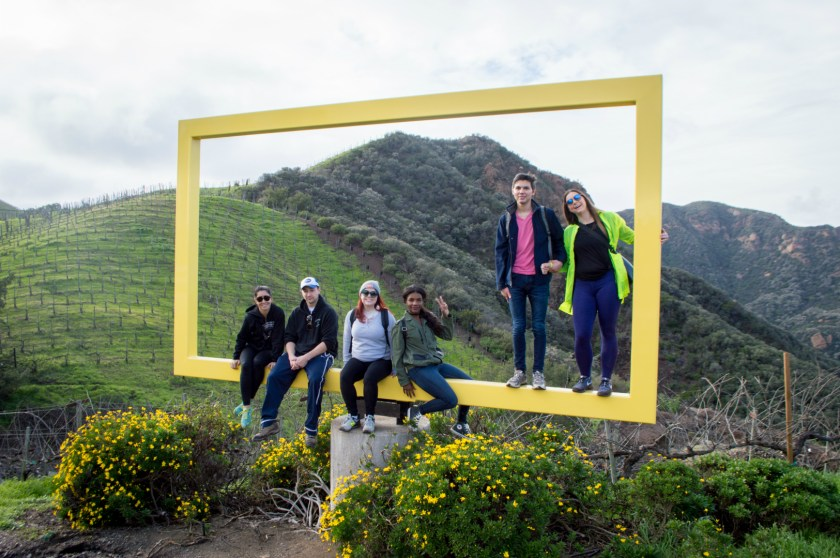 Posing on the yellow picture frame during a Malibu Wine Hike at the Saddlerock Ranch