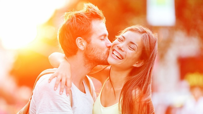 young couple kiss cheek