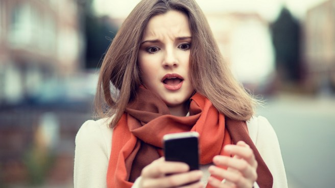 girl texting mad surprised