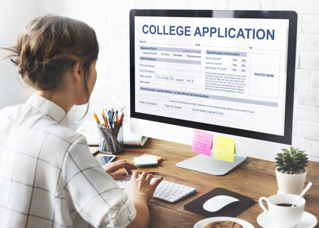 Woman applies to college online with a college application on the computer screen