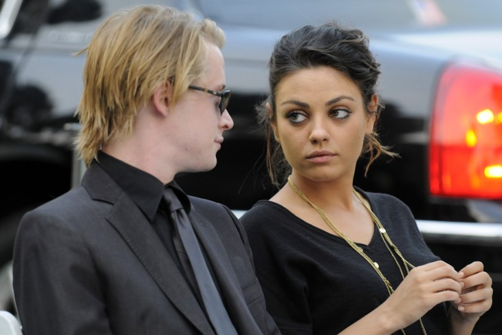 Macaulay Culkin and MIla Kunis at Michael Jackson's funeral together in California.