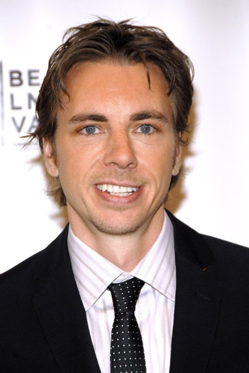 Dax Shepard smiling while looking into the camera at an event