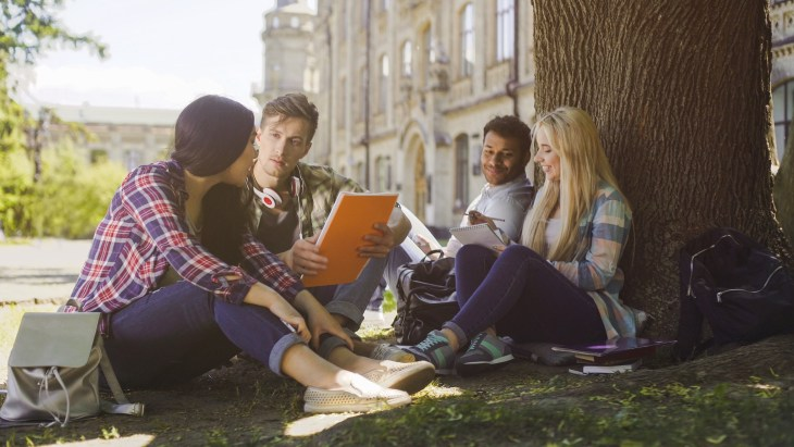Group of friends reading outside