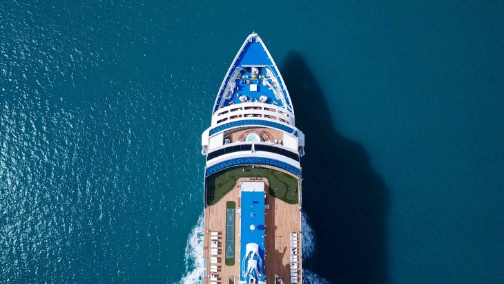Large Cruise ship sailing across The Mediterranean sea