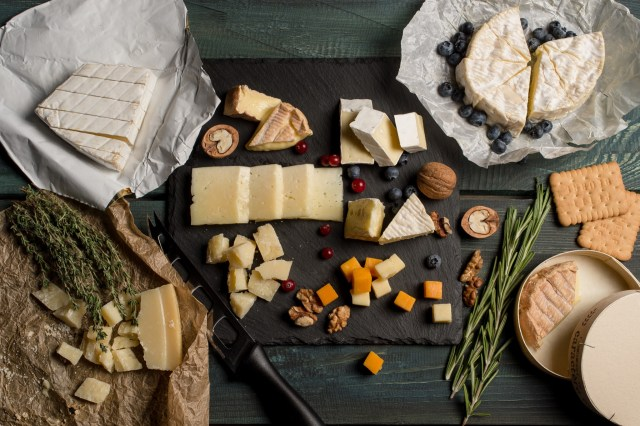 Beautiful platter of arranged cheeses and nuts
