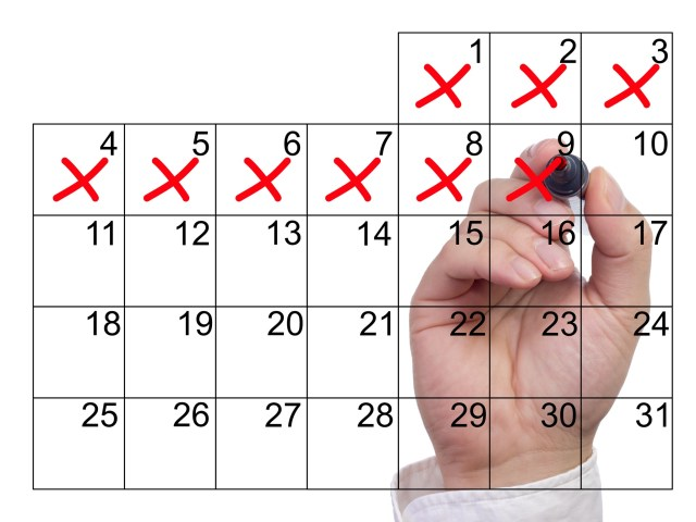 Crossing off days on transparent calendar