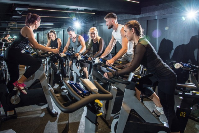 Group of women and men in a cycling class working out