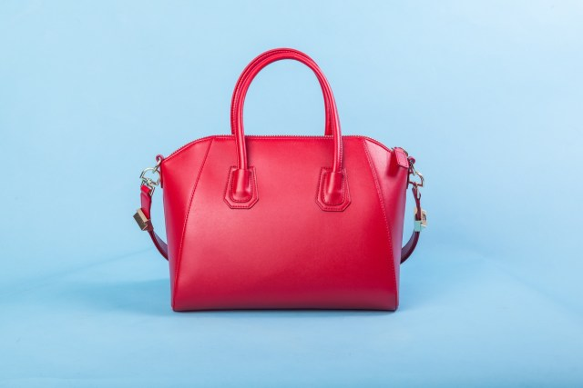 Red leather bag against blue background
