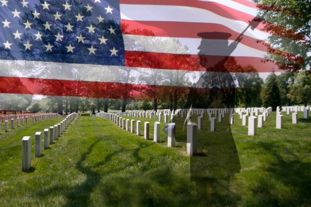 Memorial Day grave stones in a row with a soldier silhouette and an US National flag.
