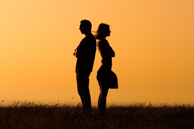 Silhouette of a angry woman and man on each other.Relationship difficulties