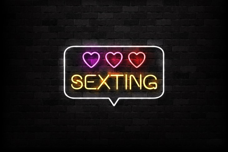 Sexting neon sign on the wall