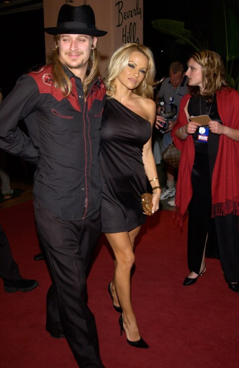 Rock star KID ROCK & girlfriend actress PAMELA ANDERSON at pre-Grammy party given by Clive Davis of J Records at the Beverly Hills Hotel. 25FEB2002