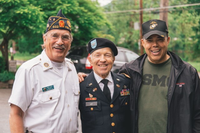 T3hree Air Force veterans smiling for the camera