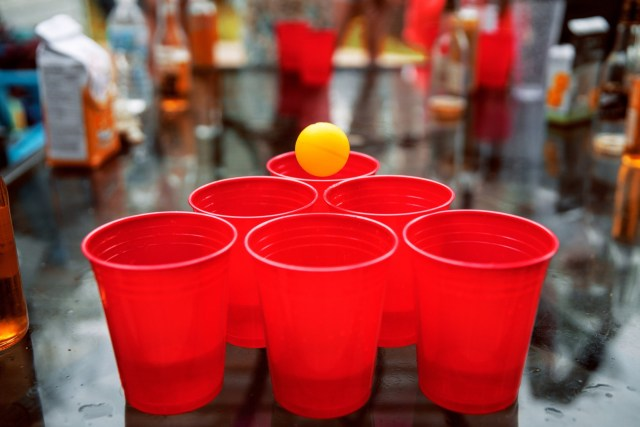 Ball rolling on top of a triangular beer pong formation.