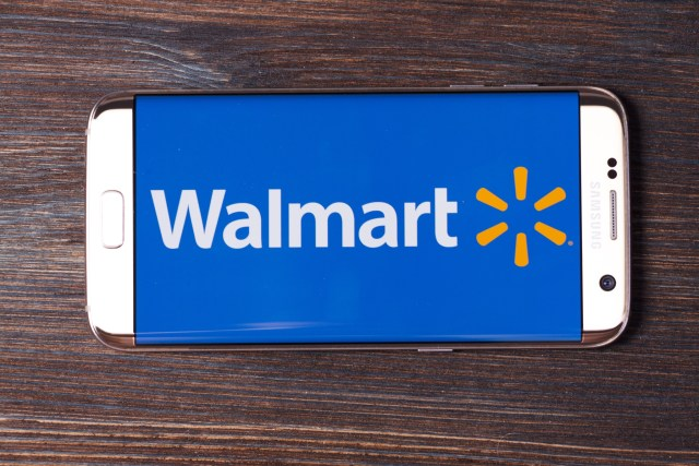 Wal-Mart shopping app on Samsung Edge white phone, laying on wooden background