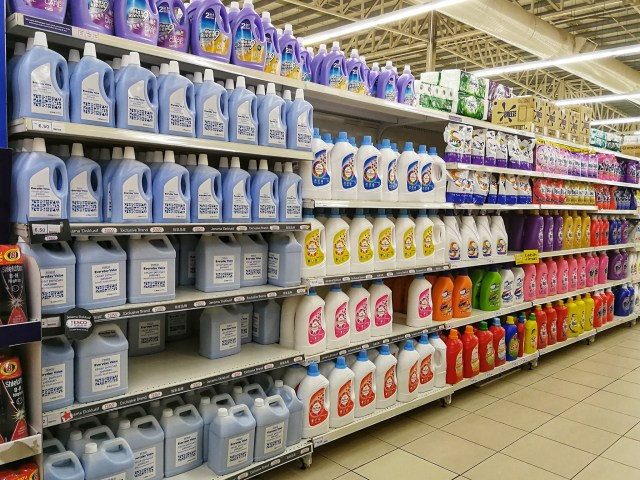 A picture of an aisle in a store with in-house brands.